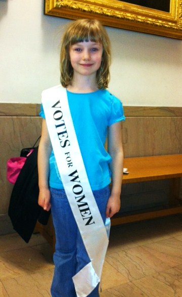 Kate Stuckart wears her sash with pride. You are never too young to learn about suffrage!